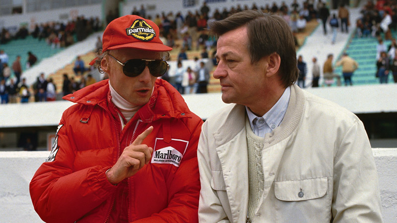 Niki Lauda talking to Hans Mezger on the pitwall