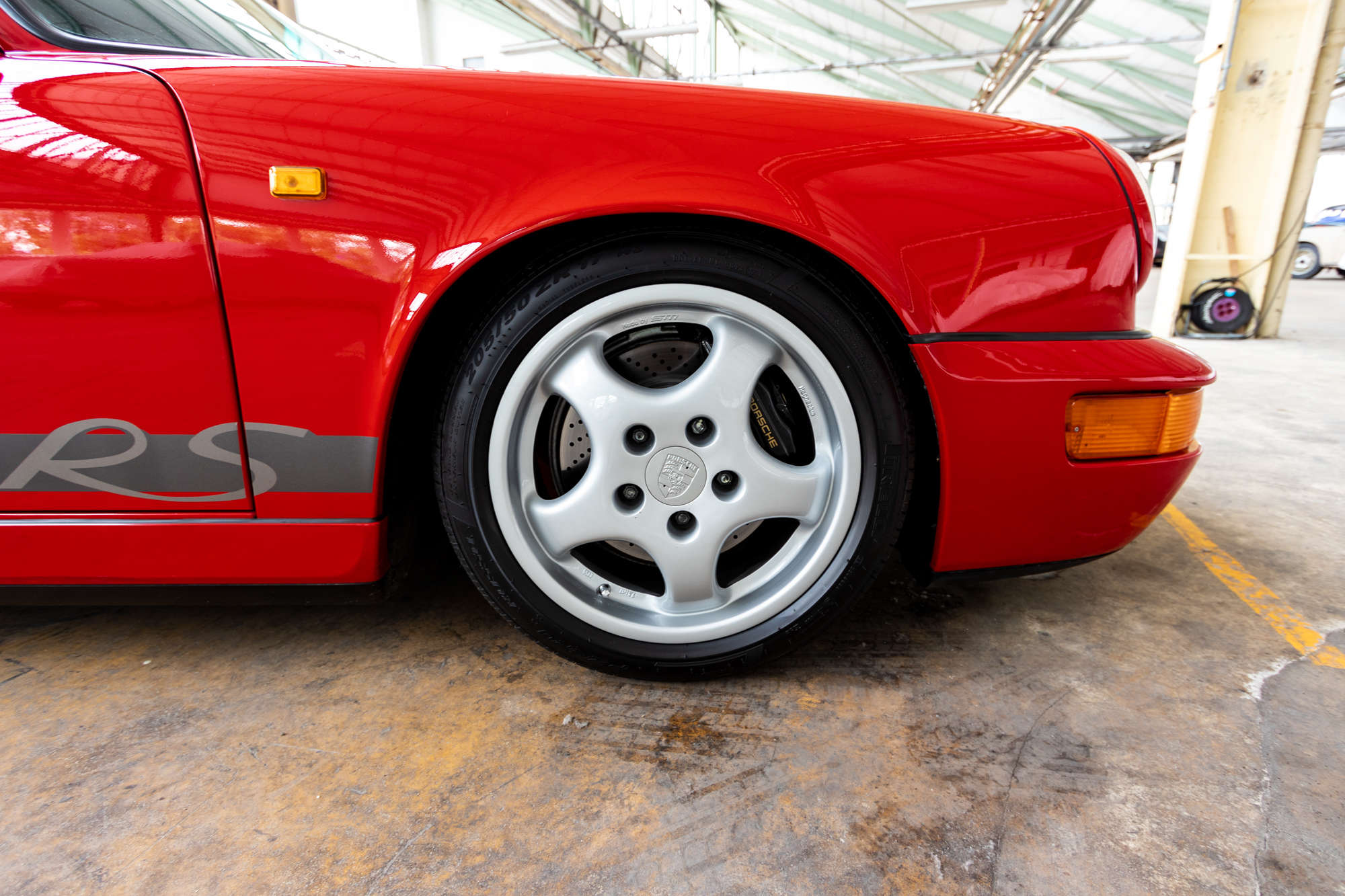 guards red Porsche 964 Carrera RS